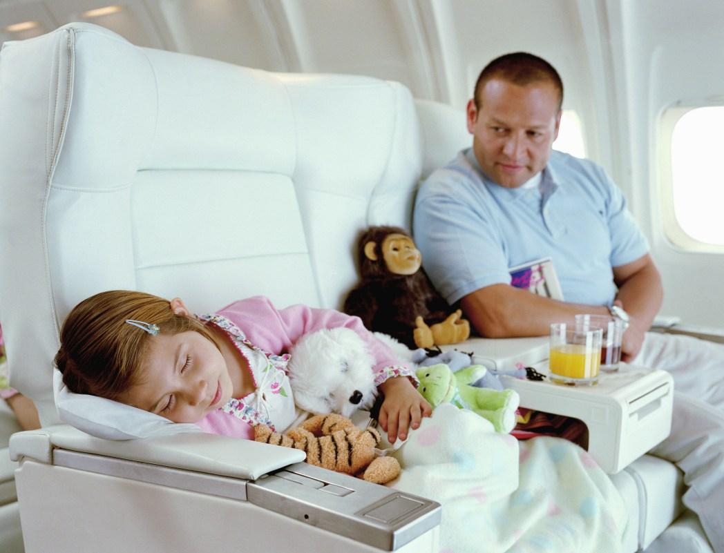 Baby sleeps on plane
