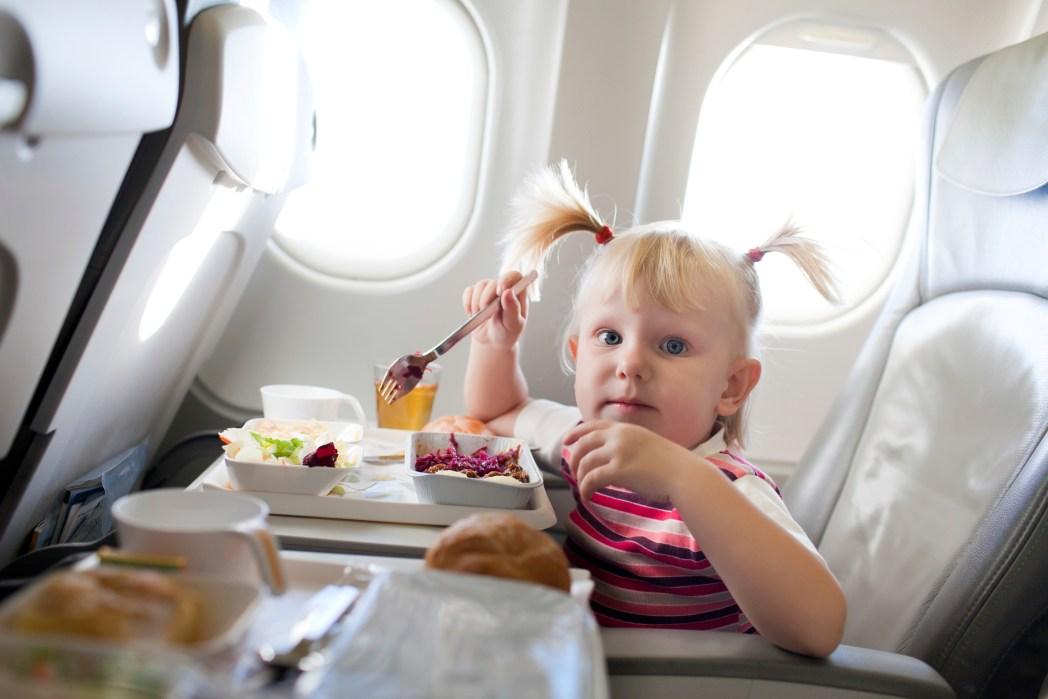 Girl eats on plane