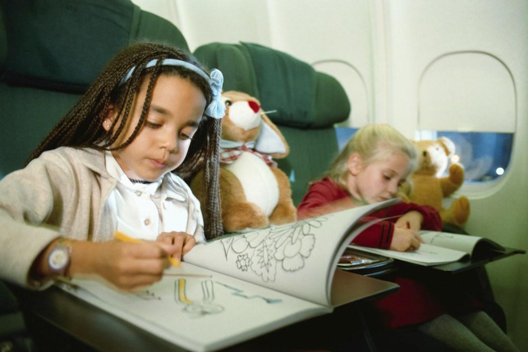 Girls draw on plane