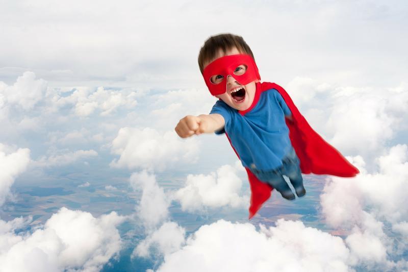 Superhero flying boy